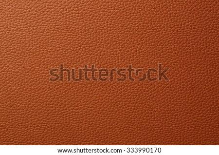 Orange leather textured background. - stock photo