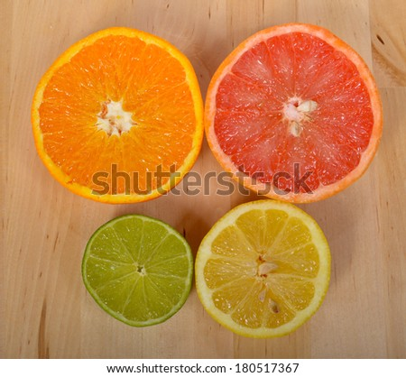 orange, lemon and grapefruit on the wood table