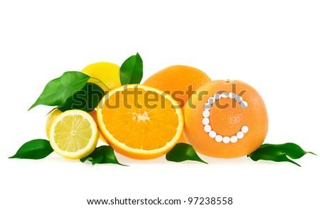 Orange, lemon, grapefruit with vitamin c pills over white background - citrus fruits concept - stock photo