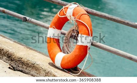 Orange lifebuoy - stock photo