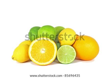 Orange, limes and lemon citrus fruits isolated on white background - stock photo
