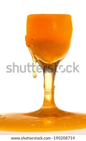 Orange Liquid in Glass - stock photo
