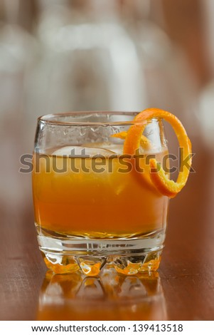 orange liquor served on the rocks with an orange twist as a garnish - stock photo