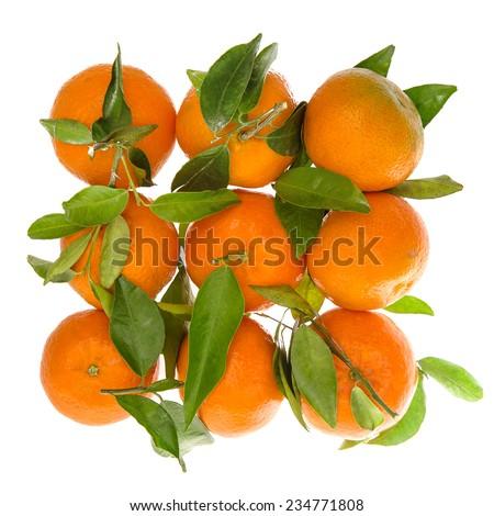 Orange mandarine with green leaves. Top view of tangerine. Selective focus - stock photo