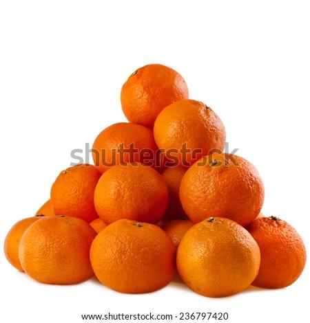 orange mandarines stacked heap isolated on white background - stock photo