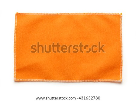 Orange microfiber cloth for glasses in closeup - stock photo