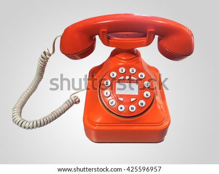 Orange old-fashioned phone on isolated white background