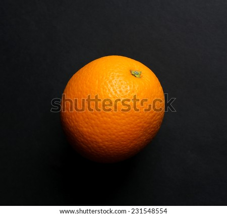 Orange on black background - stock photo
