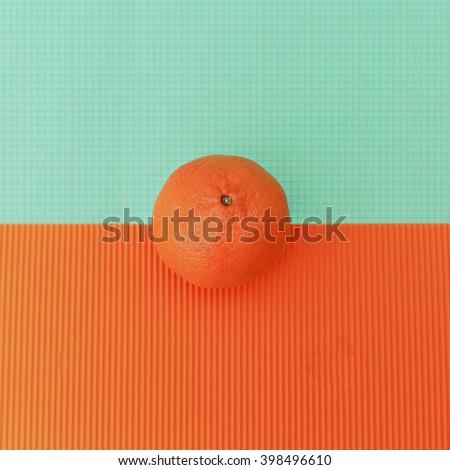 Orange on bright background. Minimalism Fashion - stock photo