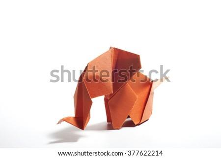 Orange origami elephant  isolated on white background - stock photo
