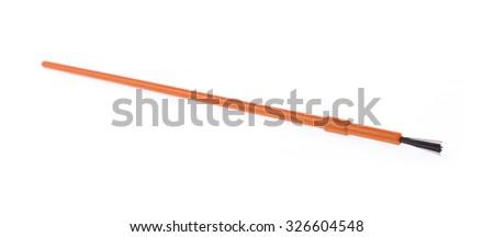 Orange paint brush isolated on white background - stock photo
