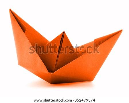 Orange paper vessel, origami sail boat, isolated on white background - stock photo