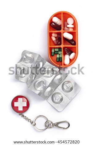orange pills box with empty pill package isolated on white