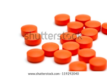 orange pills over white - stock photo