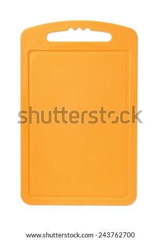 Orange plastic cutting board isolated on white - stock photo