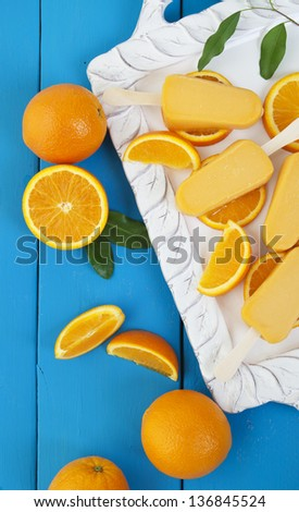 Orange popsicle ice cream bars made from fresh oranges.  A refreshing summer treat. - stock photo