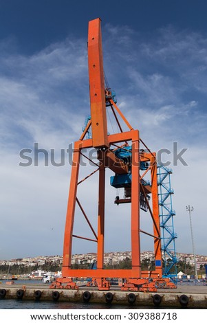 Orange Port Crane in a sea port