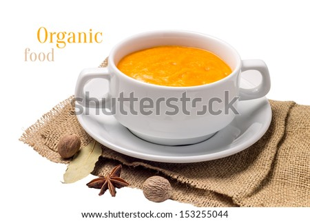 Orange pumpkin soup at old fabric isolated on white background - stock photo
