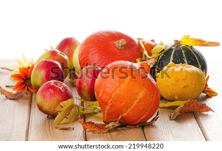 Orange Pumpkins with apples and  fall leaves isolated on white background. Selective focus - stock photo