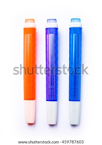 Orange, purple and blue highliters isolated on white