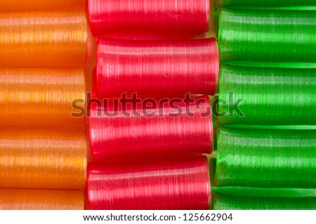Orange, Red and Green Closeup of Ribbon Candy for your Background - stock photo