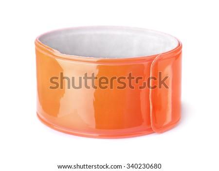 Orange reflective snap band isolated on white - stock photo