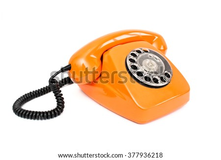 Orange retro telephone isolated on white background. - stock photo