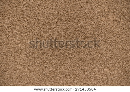 Orange revetment wall putty macro texture background - stock photo