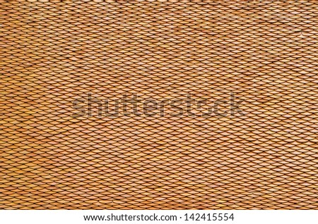 Orange roof tiles of Thai temple - stock photo