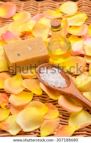 orange rose and petals ,salt in spoon ,soap,oil on mat