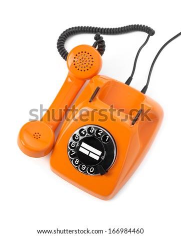 orange rotary phone on white background - stock photo