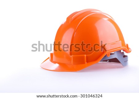 orange safety helmet hard hat, tool protect worker of danger in construction industry, isolated on white background - stock photo