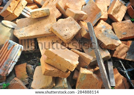 orange scrap bricks in construction.