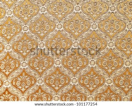 Orange seamless Thailand pattern on fabric - stock photo