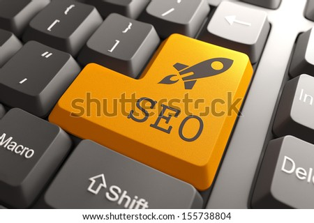 Orange SEO Button on Computer Keyboard. Information Concept. - stock photo