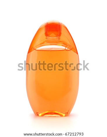 Orange shampoo bottle. Isolated on white background - stock photo