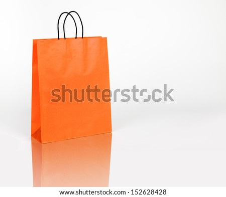 Orange shopping bag on white with space for your text or logo - stock photo