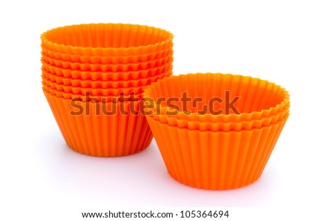 Orange silicone cupcake liners - stock photo