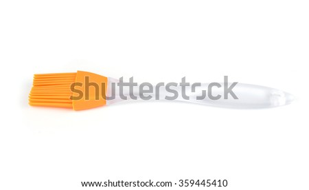 Orange silicone pastry brush isolated on white - stock photo