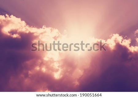 orange sky, clouds and sun behind the clouds, sun, sunrise and sunset - stock photo