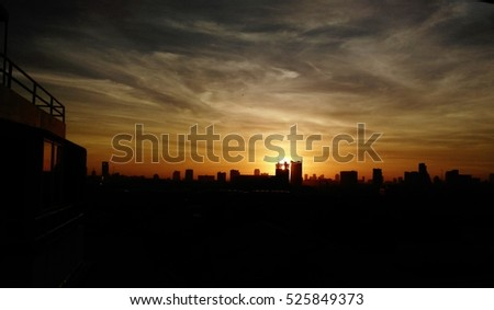 Orange sky of the  twilight on the morning with silhouette of building