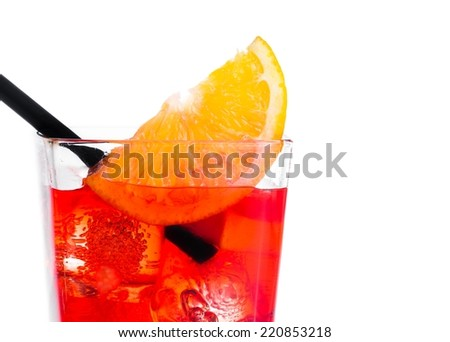 orange slice on top of the red cocktail with ice cubes and straw on white background, with space for text - stock photo