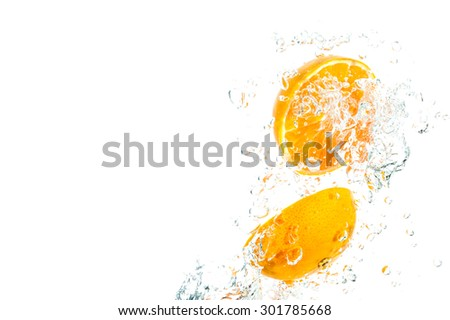 Orange Slices falling deeply under water - stock photo