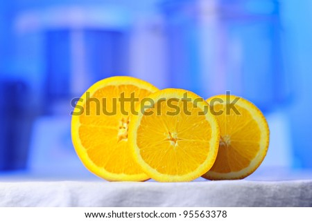 orange slices on abstract blue background, focus on a muddle slice