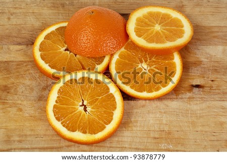 Orange slices on wooden chopping