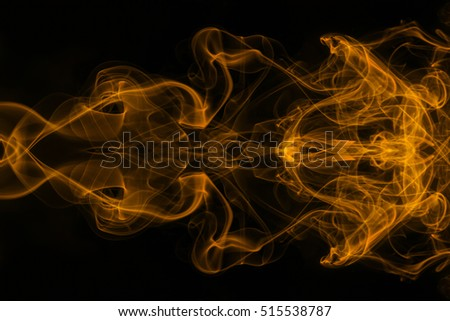 Orange smoke on black background