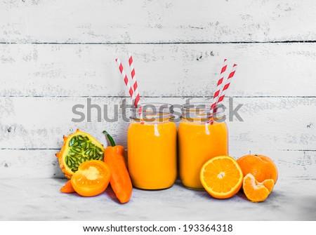 Orange smoothie on rustic background - stock photo