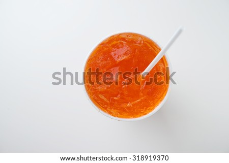 orange soda with drinking straw in disposable cup - stock photo