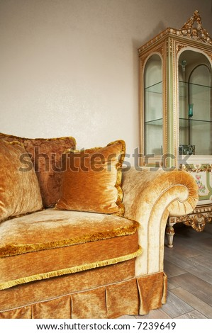 Orange sofa with pillows and a beautiful case