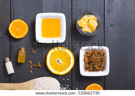 orange spa setting on old black wooden table
